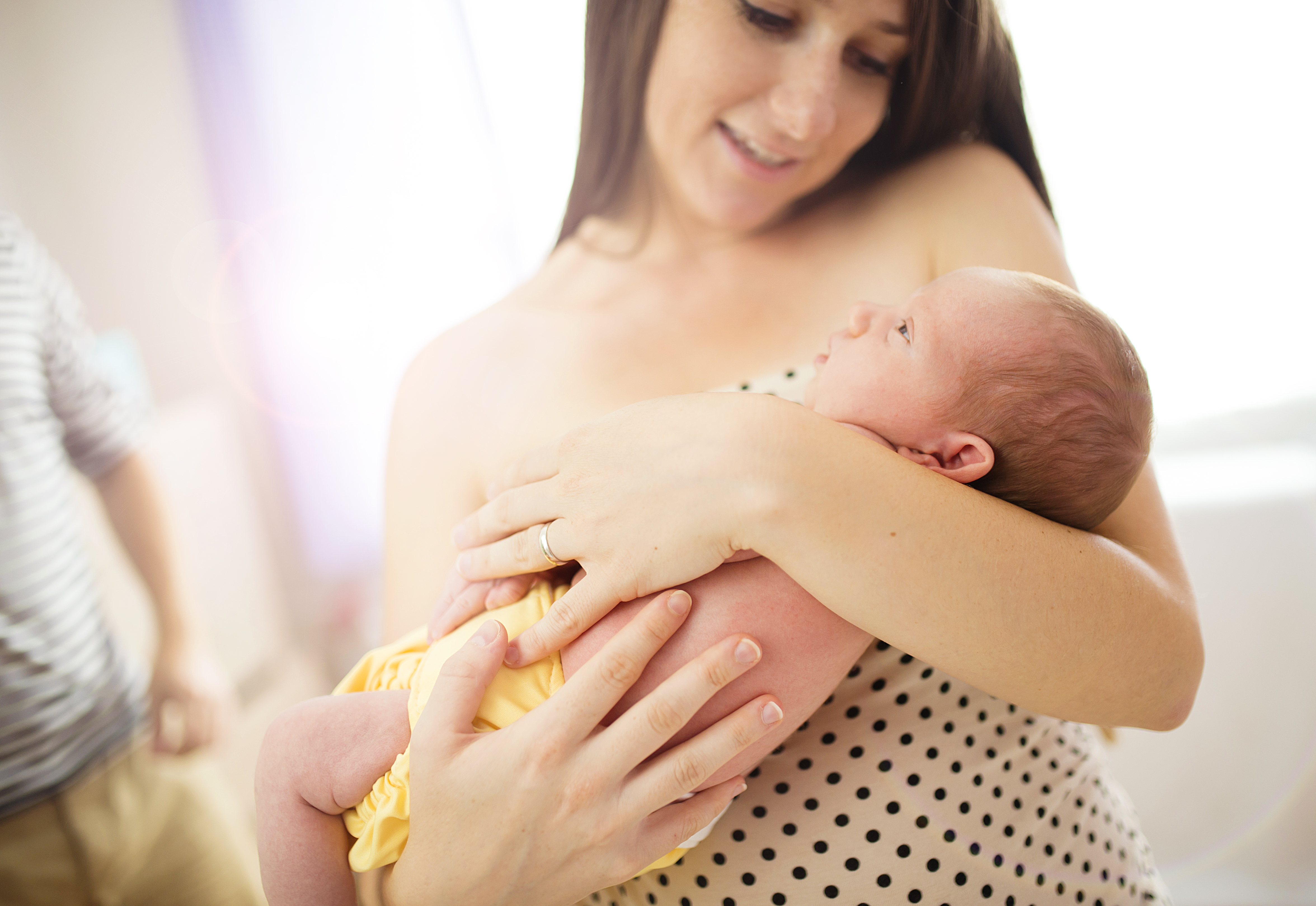 Happy mother with baby girl inside of room.