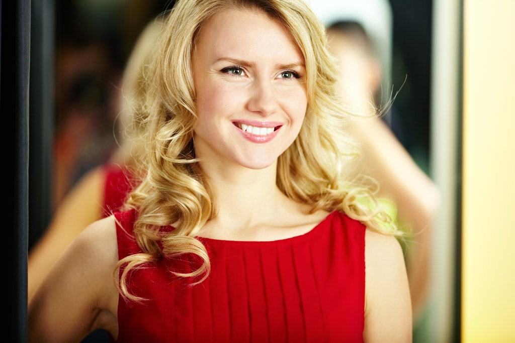 Portrait of a hot Finnish girl with blond hair smiling