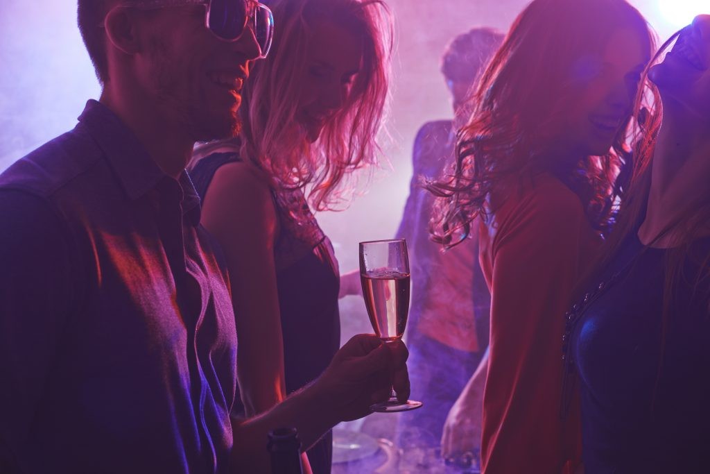 Cheerful friends enjoying party in nightclub