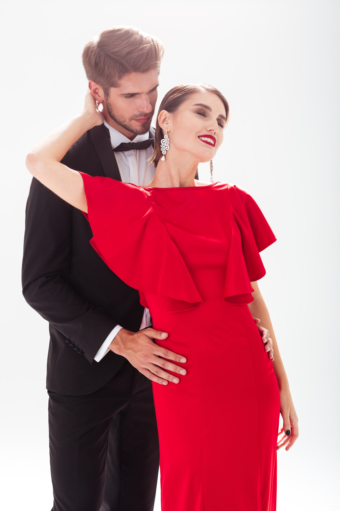 Couple in love. women in red dress. man in suit